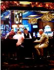 Card Players- hyperrealism acrylic painting by artist painter Gerard Boersma showing people playing cards in Las Vegas casino
