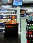 Liquor Store- hyperrealism acrylic painting by artist painter Gerard Boersma showing a woman working in a liquor store, Las Vegas