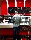 Va Bene- hyperrealism acrylic painting by artist painter Gerard Boersma showing a man in coffee bar Va Bene, Las Vegas